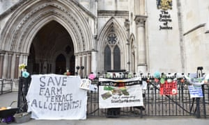 'Save Farm Terrace allotment' banners outside the high court in London.