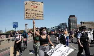 Protesters take part in a demonstration on Monday in London.