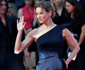 Renée Zellweger, who plays Bridget Jones, waves to fans as she arrives