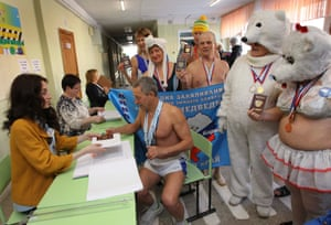 "Members of a local winter swimming club visit a polling station during the presidential election in BarnaulMembers of the winter swimming club ""Polar Bear"" visit a polling station to cast their votes during the presidential election in the city of Barnaul, Russia March 18, 2018. REUTERS/Andrei Kasprishin"