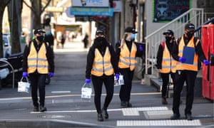 Cleaners are seen on Elizabeth Street in Melbourne, Thursday, 3 September 2020.