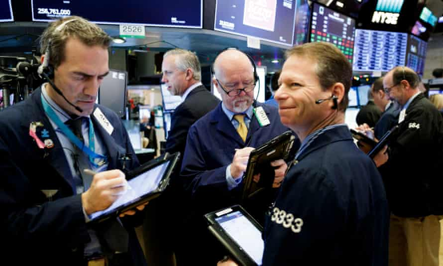 Traders on floor of New York Stock Exchange