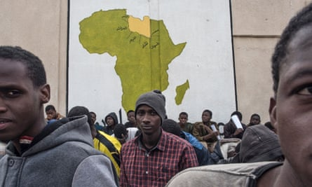 Refugees wait at the Tariq al-Matar detention centre, on the outskirts of Tripoli