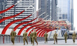 Members of the Australian Defence Force walk through Melbourne, Australia.