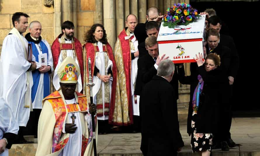 Katie Rough's coffin leaves York Minster after her funeral service.