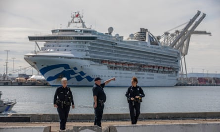 Police stand guard near the Grand Princess cruise ship docking at the Port of Oakland.