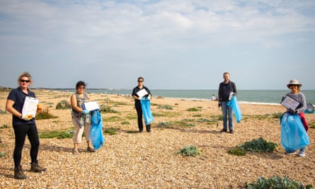 Volunteers participate in a beach litter clean-up in Cornwall.