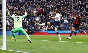 Tottenham's Fernando Llorente shoots at goal but is denied by the crossbar.