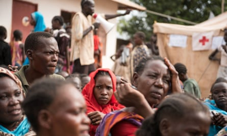 People wait to be registered as displaced persons in a South Sudan Red Cross compound in Wau.