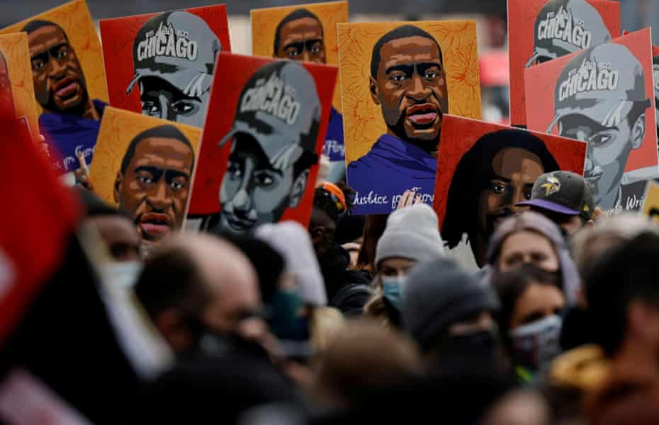 People hold placards with paintings of George Floyd, Daunte Wright and Philando Castile, all killed by Minneapolis-area police, after the verdict in Derek Chauvin's trial.