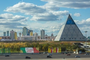 Foster's Palace of Peace and Reconciliation pyramid, with the city of Astana behind.