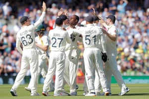 England's Jofra Archer is congratulated by his teammates after taking over from Marcus Harris of Australia.