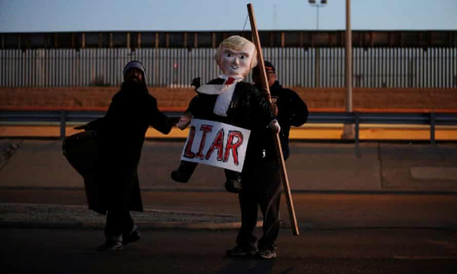 Demonstrators with an effigy of Donald Trump