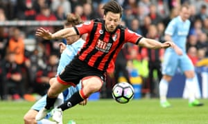 Bournemouth's Harry Arter keeps his eyes on the ball despite Stoke's Marc Muniesa taking his legs.