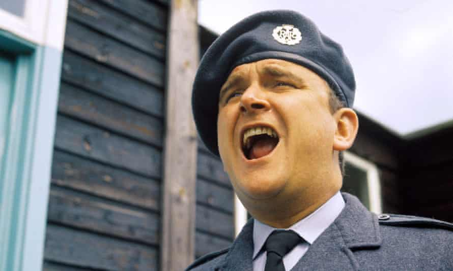 Tony Selby in 1975 as Corporal Percy Marsh in the RAF national service comedy Get Some In!