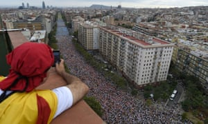 A man takes pictures of Meridiana Avenue during pro-independence demonstrations by Catalans in Barcelona.