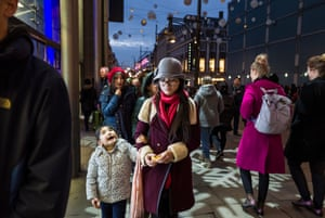 A child looks up at the festive decorations