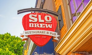 Red and white sign outside SLO Brew Restaurant and Pub. California.