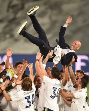 Zinedine Zidane is thrown up in the air by his players