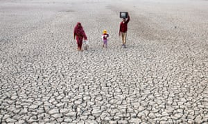 Local villagers on the dried river bed in Satkhira, Bangladesh, one of the most vulnerable continental countries to climate change.