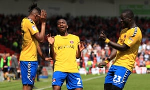 Joe Aribo, Anfernee Dijksteel and Naby Sarr celebrate a a goal at the Keepmoat Stadium, where Charlton earned a first-leg win over Doncaster.