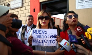 Arlette Contreras holds a sign that reads 'New trial: more abuse' after leaving a hearing in Lima in 2018. Contreras is now running for office.