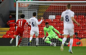 Real Madrid's keeper Thibaut Courtois thwarts Liverpool's Mohamed Salah.
