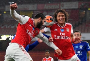 Arsenal's David Luiz (right) and Sead Kolasinac try to hold Leicester at bay.