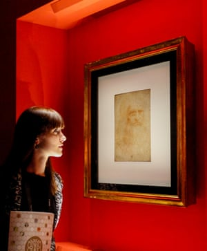 A woman examines Leonardo da Vinci's self-portrait at the Palazzo Madama, Turin.