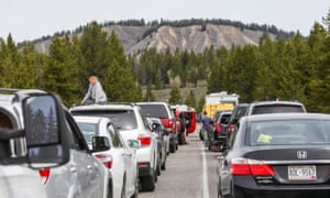 Hundreds of cars line up to enter Yellowstone and Grand Teton national parks. Cars with license plates from New York and Florida were among the visitors awaiting entry.