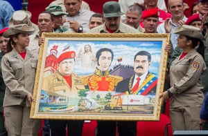 Caracas, VenezuelaVenezuelan President, Nicolas Maduro (C) holds a painting depicting (L-R) late Venezuelan President Hugo Chavez, Venezuelan liberator Simon Bolivar and himself