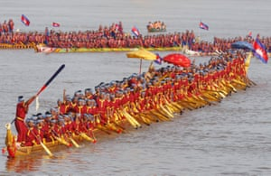 Rowers try to break the Guinness world record for the longest dragon boat on the Mekong River in Cambodia