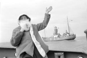 Father Christmas visits Bar Lightship in Liverpool to deliver hampers to the crew, 1971. (Archive ref. GUA-6-9-2-1-2-1497). 'It looks like Father Christmas is enjoying his boat trip. You can see the view of the other boat.'