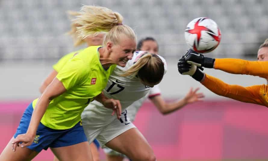 Stina Blackstenius (left) scores Sweden's first goal against the USA.