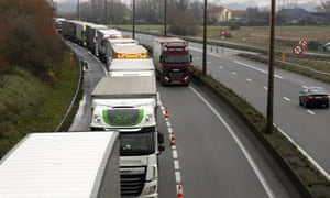 Lorries queue along the A16 motorway to board ferries and access the Eurotunnel