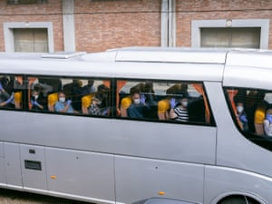 Passengers of the Ocean Atlantic wave from buses