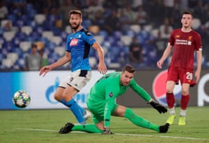 Napoli's Fernando Llorente scores their second goal as Liverpool's Adrian and Andrew Robertson look on.