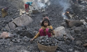 A child labourer at an opencast coalmine in India