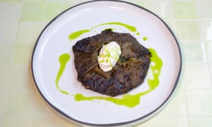 Filled vine leaves on a round white plate