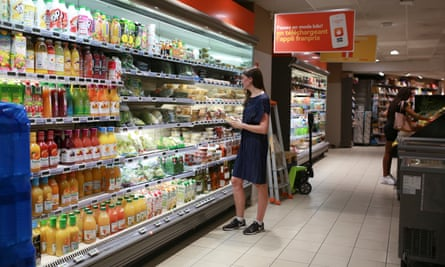 As advised by the health department, Megan Clement lingers in one of the air-conditioned supermarkets in the 18th arrondissement