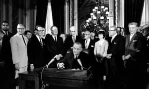 Lyndon Johnson signs the Voting Rights Act of 1965.