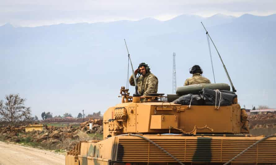 Turkish soldiers in a tank are transported as part of Operation Olive Branch, after dozens of airstrikes hit more than 150 targets in Afrin, Syria.