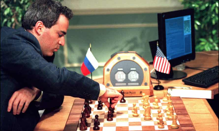 Garry Kasparov makes a move in New York during his fourth game against the IBM Deep Blue chess computer, May 1997.