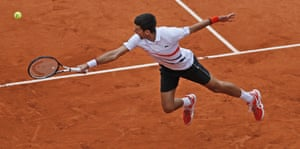 Novak Djokovic flies wide for a backhand.