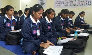 Students on an Indian government pilot training scheme to become taxi drivers