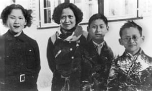 Circa 1934 the future king of Thailand Bhumibol Adulyadej (right) stands with his mother, Princess Srinagarindra, elder sister princess Galyani Vadhana (left) and brother Prince Ananda Mahidol (second from right) during a visit to Switzerland