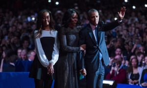 President Barack Obama, first lady Michelle Obama and daughter Malia Obama wave goodbye to supporters after Obama's farewell address.