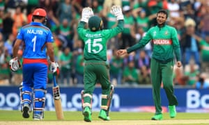 Bangladesh's Shakib Al Hasan celebrates taking the wicket of Najibullah Zadran.