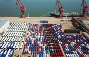 Vehicles wait for shipment at Lianyungang Port on August 8, 2018 in Lianyungang, Jiangsu Province of China.