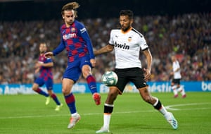 Valencia's Ezequiel Garay, right, in action here against Barcelona, has criticised the sacking of Marcelino.